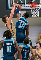 WASHINGTON, DC - FEBRUARY 8: Cyril Langevine #10 of Rhode Island stops a shot by Chase Paar #3 of George Washington during a game between Rhode Island and George Washington at Charles E Smith Center on February 8, 2020 in Washington, DC.