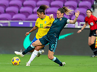 ORLANDO, FL - FEBRUARY 18: Cristiane #11 of Brazil crosses the ball around Aldana Cornetti #6 of Argentina during a game between Argentina and Brazil at Exploria Stadium on February 18, 2021 in Orlando, Florida.