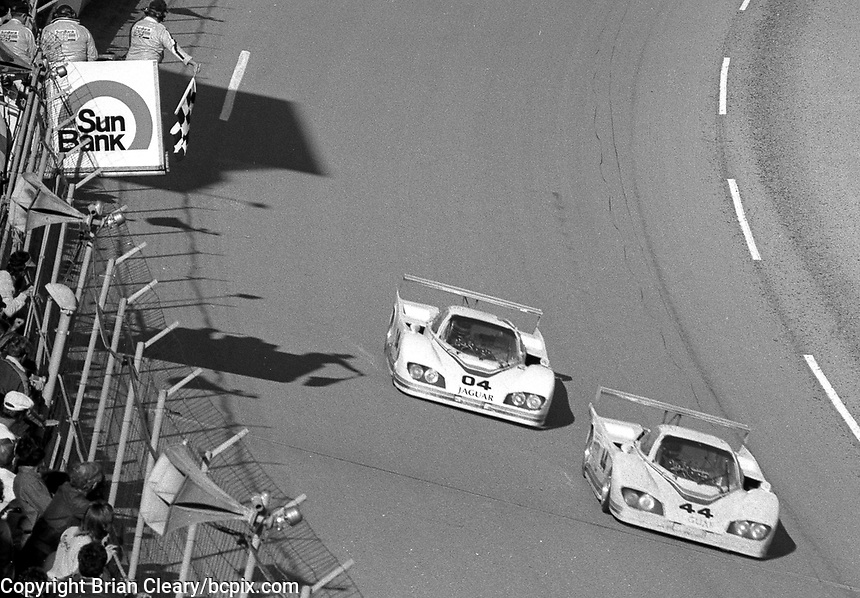 The checkered flags waves for the #44 Jaguar XJR-5 of Coc Bundy, David Hobbs and Bob Tullius and the #04 Jaguar XJR-5 of Bill Adam, Pat Bedard and Brian Redman which finished 3rd and 24th respectively in the SunBank 24 at Daytona, Daytona International Speedway, Daytona Beach, FL, Feb. 4-5, 1984. (Photo by Brian Cleary/www.bcpix.com)