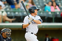 Dan Johnson #24 of the Charlotte Knights follows through on his swing against the Toledo Mud Hens at Knights Stadium on May 10, 2012 in Fort Mill, South Carolina.  (Brian Westerholt/Four Seam Images)