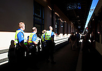 Switzerland. Canton Ticino. Chiasso. Railway station. Four border guards are checking the passengers of a local train arriving from Italy. About 90 per cent of illegal immigrants who want to get into Switzerland try their chance by train. No specific measures are yet planned by the border guards, but an emergency, reinforcements from other parts of Switzerland is dispatched in Ticino as prevention to a potential massive arrival of economic migrants. 08.04.11 © 2011 Didier Ruef