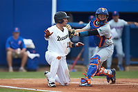 Keegan Maronpot (13) of the Wake Forest Demon Deacons signals safe as Florida Gators catcher JJ Schwarz (22) applies a tag during the completion of Game Two of the Gainesville Super Regional of the 2017 College World Series at Alfred McKethan Stadium at Perry Field on June 12, 2017 in Gainesville, Florida. The Demon Deacons walked off the Gators 8-6 in 11 innings. (Brian Westerholt/Four Seam Images)