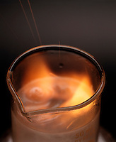 SODIUM REACTS VIOLENTLY WITH WATER<br /> Elemental Sodium Dropped Into Beaker of Water<br /> Sodium, an alkali metal, dropped in water forms hydrogen gas and an alkali solution of sodium hydroxide. This is a single replacement reaction.  2Na(s) + 2H2O(l) -> 2NaOH(aq) + H2(g)