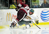 24 November 2009: University of Vermont Catamount forward Justin Milo, a Junior from Edina, MN, slides into the boards during a game against the University of Massachusetts Minutemen at Gutterson Fieldhouse in Burlington, Vermont. The Minutemen defeated the Catamounts 6-2. Mandatory Credit: Ed Wolfstein Photo