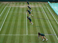 3rd July 2021; Wimbledon, SW London. England; Wimbledon Tennis Championships, day 6;  The covers are pulled onto court as it starts to rain