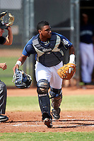 San Diego Padres minor league catcher Jairo Gomez #4 during an instructional league game against the Seattle Mariners at the Peoria Sports Complex on October 6, 2012 in Peoria, Arizona.  (Mike Janes/Four Seam Images)
