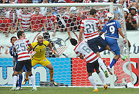 Rafael Burgos (9) of El Salvador heads the ball against Clarence Goodson (21) of the USMNT. The USMNT defeated El Salvador 5-1 at the quaterfinal game of the Concacaf Gold Cup, M&T Stadium, Sunday July 21 , 2013.