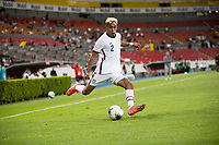 , MEXICO - : Julian Araujo #2 of the United States crosses a ball during a game between  and undefined at  on ,  in , Mexico.