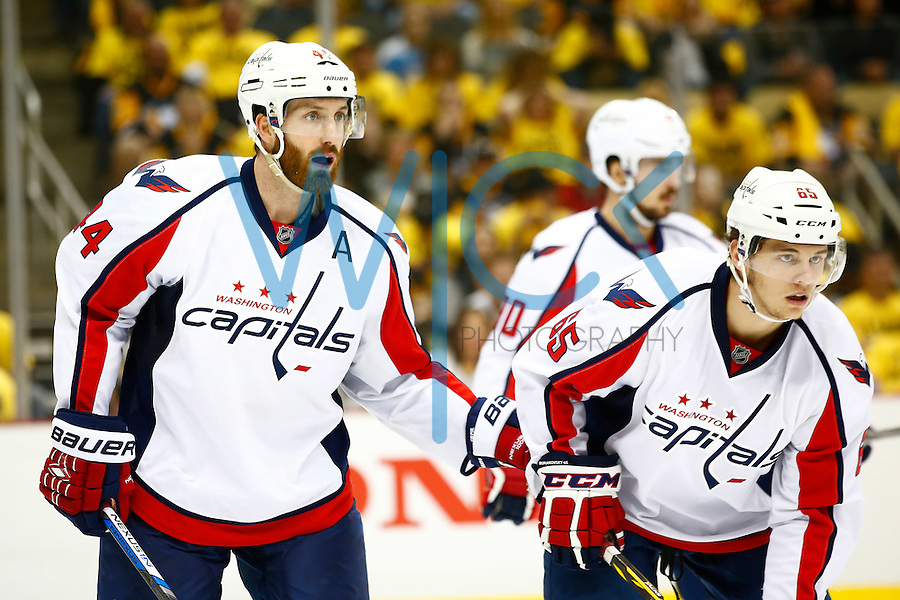 Brooks Orpik #44 of the Washington Capitals talks with Andre Burakovsky #65 of the Washington Capitals in overtime against the Pittsburgh Penguins during game six of the second round of the Stanley Cup Playoffs at Consol Energy Center in Pittsburgh, Pennsylvania on May 10, 2016. (Photo by Jared Wickerham / DKPS)
