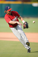 Second baseman Michael Bell (5) of the Huntsville Stars makes an off-balance throw to first base during infield practice at the Baseball Grounds in Jacksonville, FL, Thursday June 12, 2008.