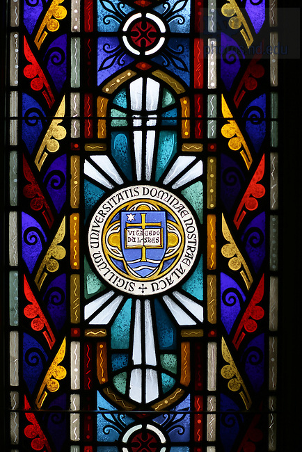 University Seal in a stained glass window in the old Law School Chapel.<br /> <br /> Photo by Matt Cashore/University of Notre Dame