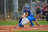 Pitt Panthers catcher Riley Wash (33) fields a throw as Jordan Schaffer (1) slides home during the teams opening game of the season against the Indiana State Sycamores on February 19, 2021 at North Charlotte Regional Park in Port Charlotte, Florida.  (Mike Janes/Four Seam Images)