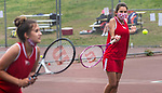 WOLCOTT, CT 050821JS22—Wolcott's Erjona Zhuta, right, returns a shot as her doubles partner Jenna Marciano, left, stays ready during their match with Watertown's Lira Cenka  and Emalyn Osborne in their NVL match-up Saturday at Wolcott High School. <br /> Jim Shannon Republican American