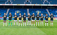 SOLNA, SWEDEN - APRIL 10: The USWNT stands for the national athem before a game between Sweden and USWNT at Friends Arena on April 10, 2021 in Solna, Sweden.