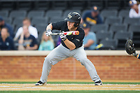 Jonathan Pryor (11) of the Wake Forest Demon Deacons squares to bunt against the West Virginia Mountaineers in Game Six of the Winston-Salem Regional in the 2017 College World Series at David F. Couch Ballpark on June 4, 2017 in Winston-Salem, North Carolina.  The Demon Deacons defeated the Mountaineers 12-8.  (Brian Westerholt/Four Seam Images)