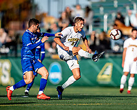 26 October 2019: University of Vermont Catamount Defender Arnar Steinn Hansson, a Senior from Garðabær, Iceland, keeps the ball away from University of UMass Lowell River Hawk Forward Mario Mora Perez, a Freshman from Liberia, Costa Rica, in the second half of NCAA Soccer play at Virtue Field in Burlington, Vermont. The Catamounts rallied to defeat the River Hawks 2-1, propelling the Cats to the America East Division 1 conference playoffs. Mandatory Credit: Ed Wolfstein Photo *** RAW (NEF) Image File Available ***