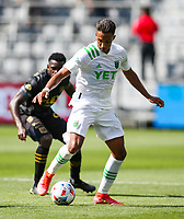 LOS ANGELES, CA - APRIL 17: Danny Hoesen #9 of Austin FC passes off the ball during a game between Austin FC and Los Angeles FC at Banc of California Stadium on April 17, 2021 in Los Angeles, California.