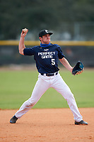 Third baseman Miles Curley (5) throws to first base during the Perfect Game National Underclass East Showcase on January 23, 2021 at Baseball City in St. Petersburg, Florida.  (Mike Janes/Four Seam Images)