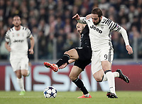Porto's Andre' Andre', left, and Juventus' Gonzalo Higuain fight for the ball during the Champions League round of 16 soccer match against Porto at Turin's Juventus Stadium, 14 March 2017.<br /> UPDATE IMAGES PRESS/Isabella Bonotto