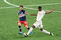 FOXBOROUGH, MA - MAY 22: Carles Gil #22 of New England Revolution fails to pass Andres Reyes #4 of New York Red Bulls during a game between New York Red Bulls and New England Revolution at Gillette Stadium on May 22, 2021 in Foxborough, Massachusetts.