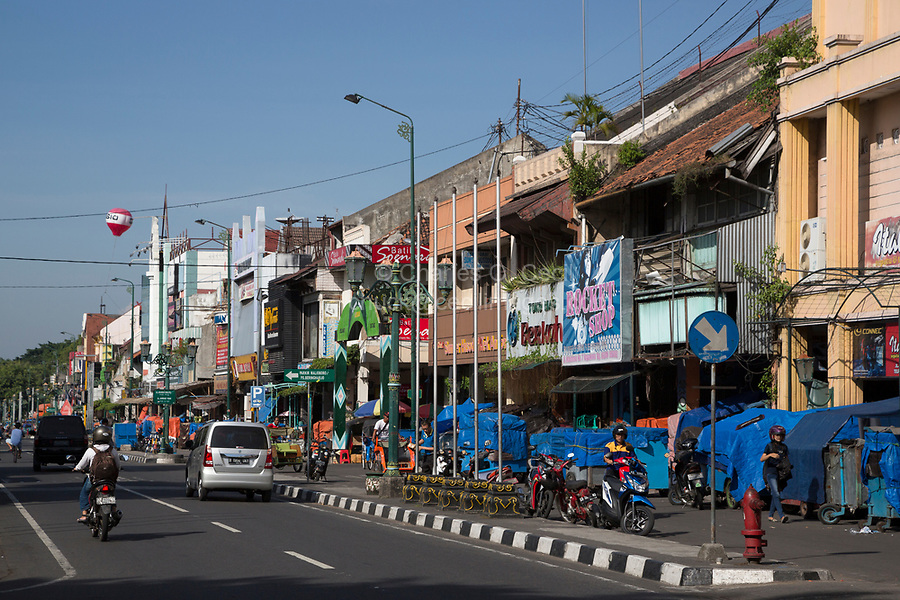 Yogyakarta, Java, Indonesia.  Malioboro Street, early Morning.  Blue Plastic Covers Vendors' Stands not yet Open for Business.