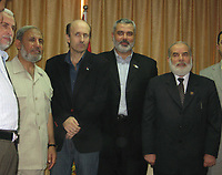 "British Broadcasting Corporation reporter Alan Johnston, left, and former Palestinian Prime Minister Ismail Haniyeh of Hamas wave as they meet in Gaza City, Wednesday, July 4, 2007. Johnston was released early Wednesday after nearly four months in captivity in the Gaza Strip.""photo by Fady Adwan"""