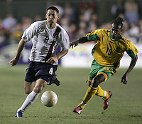 APR 11, 2006: Cary, North Carolina:  USMNT midfielder (8) Clint Dempsey sprints down the field away from Jamaican defender (19) Garfield Reid during a friendly at the SAS Soccer Park in Cary, North Carolina