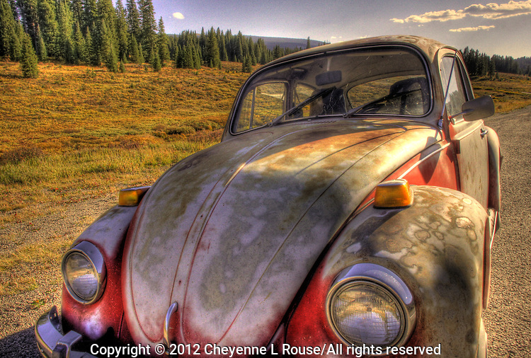 Abandoned Volkswagon Bug on Lizard Head Pass near Telluride Colorado in the fall.