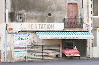 Alimentation Generale, a closed grocery store. Montpeyroux. Languedoc. Empty shelves during lunch time. France. Europe.