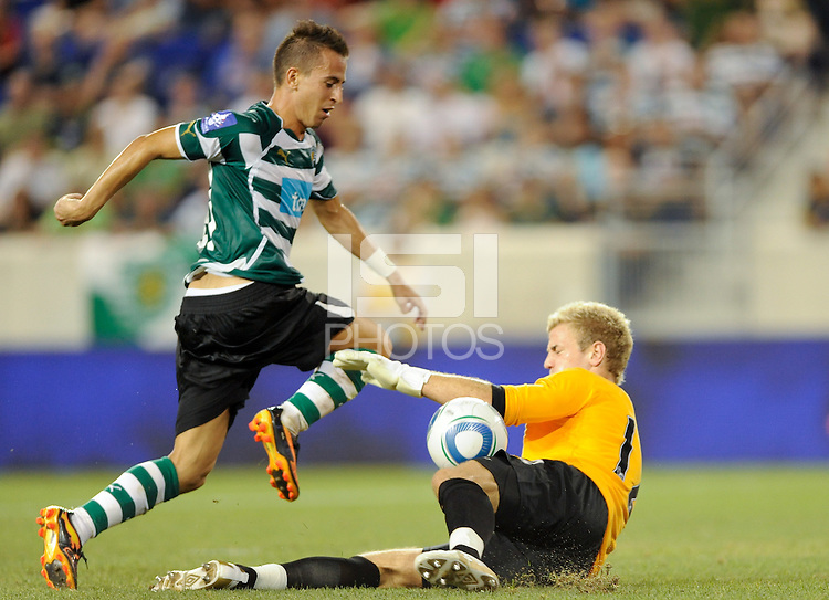 Manchester City F. C.goalkeeper Joe Hart (12) makes a save on Joao Pereira (47) of Sporting Clube de Portugal. The play would be waved off for off sides.  Sporting Clube de Portugal defeated Manchester City F. C. 2-0 during a Barclays New York Challenge match at Red Bull Arena in Harrison, NJ, on July 23, 2010.