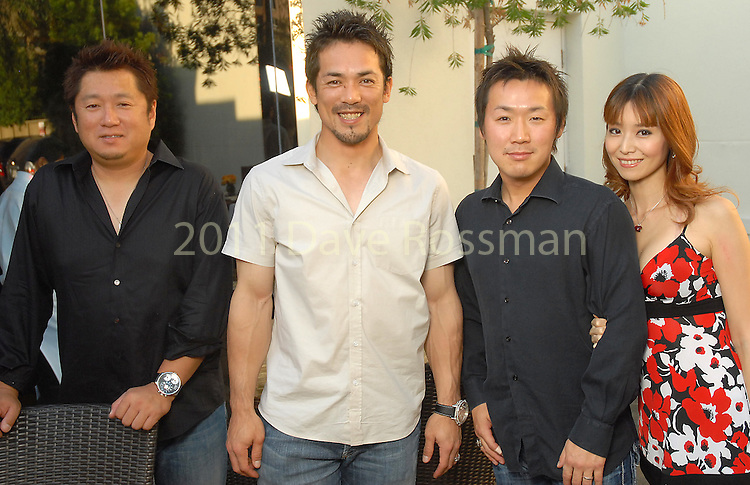 Katsumi Oka, Kazuo Matsui, Yoshitaka Ono and Chisato Ono at the Astros Wives party at Mo's..A Place for Steaks Sunday evening June 07,2009.(Dave Rossman/For the Chronicle)