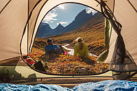 Camping with a view from the tent at the arrigetch creek valley, Xanadu (left) Arial and Caliban mountains, Brooks Range, Gates of the Arctic National Park, Alaska.