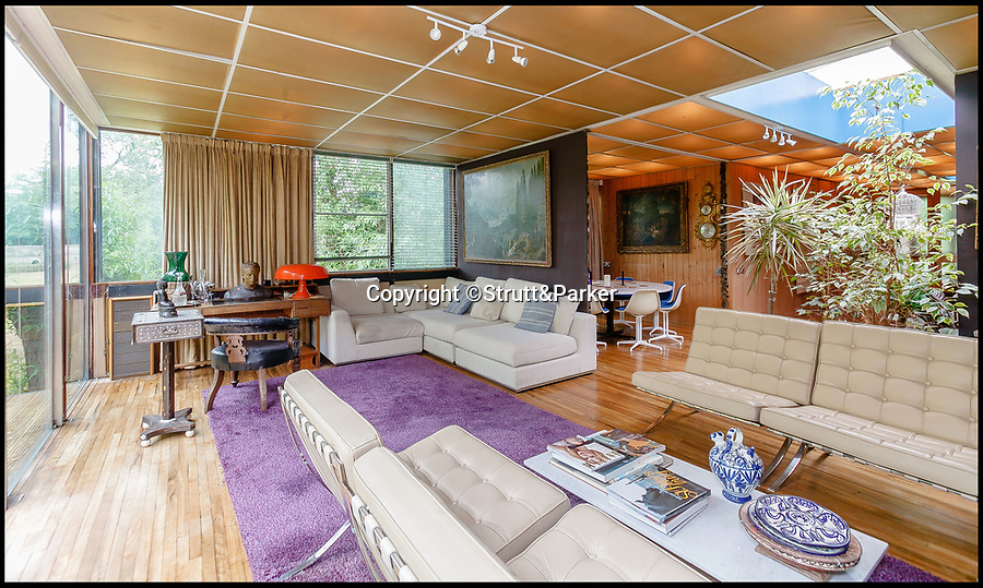 BNPS.co.uk (01202 558833)<br /> Pic: Strutt&Parker/BNPS<br /> <br /> Open plan 60' style interior.<br /> <br /> Noah Way...Escape the floods in this super cool modern ark.<br /> <br /> This amazing riverside home built on stilts has emerged for sale for £1.25million.<br /> <br /> Bridge End House in idyllic Dorchester-on-Thames, Oxon, is perched on 8ft steel girders keeping it clear of the regular floods.<br /> <br /> The architect designed home is built on seven acres of riverside land just 50ft from the River Thame, which filters into the River Thames, and floods every few years.<br /> <br /> Husband and wife architect team Donald Morrison and Julia Fielding built their future proof dream home in 1965 and lived happily there for over 50 years.