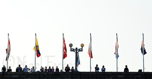 11 SEP 2011 - BEIJING, CHN - Spectators watch the 2011 ITU World Age Group Olympic Distance Triathlon Championships from the top of the reservoir's dam (PHOTO (C) NIGEL FARROW)