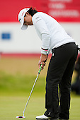 Yani Tseng holes out at the 18th green during the first round play of the  Ricoh Woman's British Open to be played over the Championship Links from 28th to 31st July 2011; Picture Stuart Adams, SAFOTO. www.safoto.co.uk; 28th July 2011