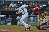 Asheville Tourists first baseman Correlle Prime #32 swings at a pitch during a game against the Greenville Drive at McCormick Field June 24, 2014 in Asheville, North Carolina. The Tourists defeated the Drive 5-4. (Tony Farlow/Four Seam Images)