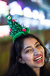"""© Joel Goodman - 07973 332324 . 16/12/2017. Manchester, UK. A woman wearing a Christmas tree hat at Deansgate Locks . Revellers out in Manchester City Centre overnight during """" Mad Friday """" , named for historically being one of the busiest nights of the year for the emergency services in the UK . Photo credit : Joel Goodman"""