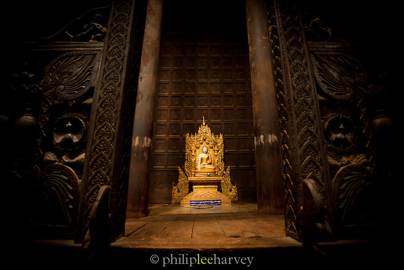 A buddha shrine in the Bagaya Monastery, which is all made from teak wood, in the ancient city of Ava, Myanmar