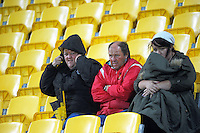 Fans brave the weather to watch the Swindale Shield club rugby match between Old Boys University and Wellington Axemen at Westpac Stadium, Wellington, New Zealand on Saturday, 23 April 2016. Photo: Dave Lintott / lintottphoto.co.nz