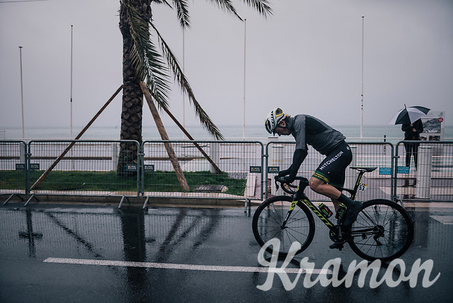 Australian National Champion Alexander Edmondson (AUS/Michelton-Scott) on his way to the race start on the Promenade des Anglais in torrential rained down Nice (and next to the Mediterranean Sea)<br /> <br /> 76th Paris-Nice 2018<br /> Stage 8: Nice > Nice (110km)