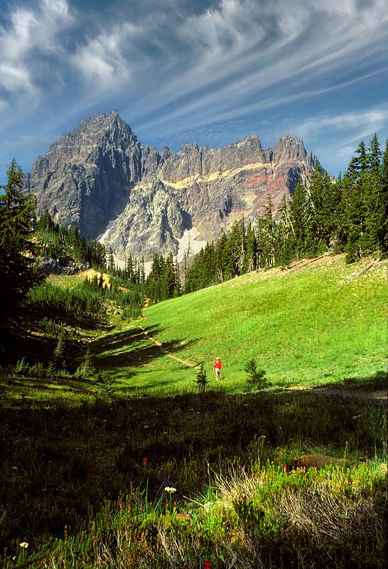 Hiker at base of Three Fingered Jack Mountain. Oregon.