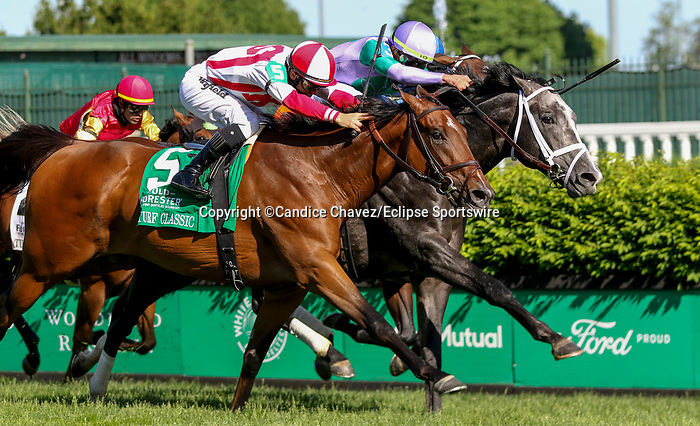 May 1, 2021 : Colonal Liam with Irad Ortiz and Domestic Spending with Flavien Prat win the Old Forester Bourbon Turf Classic in a dead heat on Kentucky Derby Day at Churchill Downs on May 1, 2021 in Louisville, Kentucky. Candice Chavez/Eclipse Sportswire/CSM