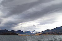 Dark clouds roll in over Skilak Lake as only the distant shore sees the sun.