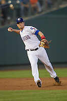 Round Rock Express third baseman Alex Bucholz #5 makes a running throw to first base during the Pacific Coast League baseball game against the Memphis Redbirds on April 24, 2014 at the Dell Diamond in Round Rock, Texas. The Express defeated the Redbirds 6-2. (Andrew Woolley/Four Seam Images)