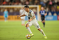 CARSON, CA - SEPTEMBER 21: Cristian Pavon #10 oof the Los Angeles Galaxy moves with the ball during a game between Montreal Impact and Los Angeles Galaxy at Dignity Health Sports Park on September 21, 2019 in Carson, California.