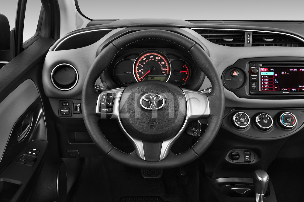 Car pictures of steering wheel view of a 2015 Toyota Yaris LE 3-Door Liftback AT 3 Door Hatchback Steering Wheel