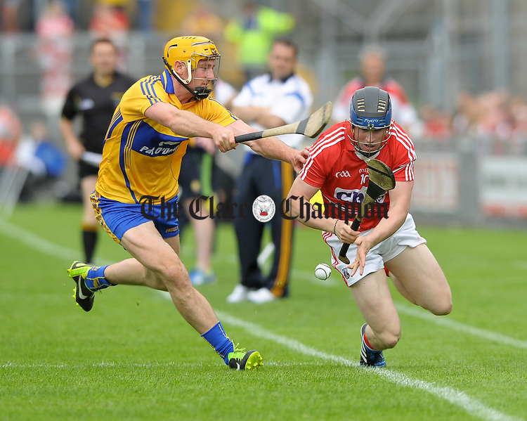 Cian Dillon of Clare in action against Conor Lehane of Cork during the Senior hurling championship semi-final at Thurles. Photograph by John Kelly.l