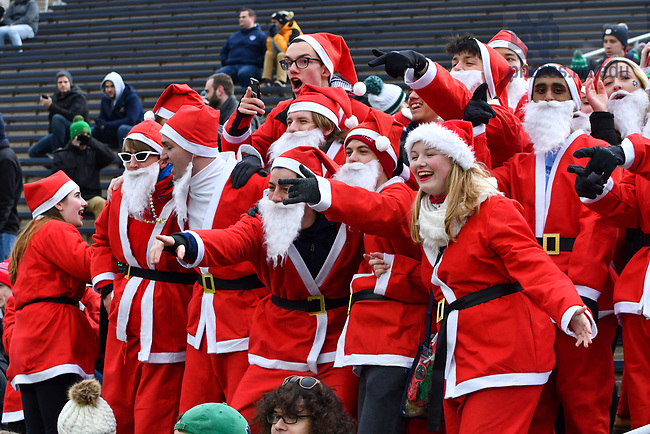 November 23, 2019; A group of students wearing Santa Claus suits gather together for the final home football game of 2019. According to one student the idea came from a Halloween costume. (Photo by Matt Cashore)