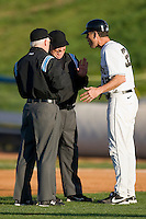 Wake Forest Demon Deacons head coach Tom Walter #32 argues with umpires Gerald Trexler (R) and Roger Kinley after they reversed a balk call against the Charlotte 49ers at Wake Forest Baseball Park March 30, 2010, in Winston-Salem, North Carolina.  Photo by Brian Westerholt / Four Seam Images