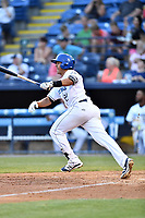 Asheville Tourists third baseman Colton Welker (24) swings at a pitch during a game against the West Virginia Power at McCormick Field on May 10, 2017 in Asheville, North Carolina. The Tourists defeated the Power 4-3. (Tony Farlow/Four Seam Images)